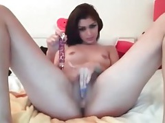 Shaved camgirl cunt pleasured by a toy tubes