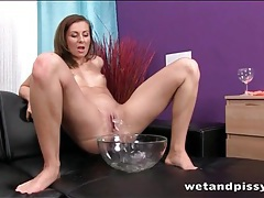 Pissing in a bowl and soaking her feet in it tubes