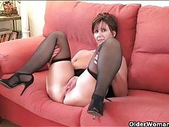 Classy mature babe models her little black dress tubes