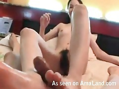 Footjob from an asian girl with a great bush tubes