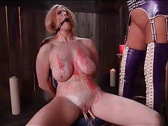Hot wax dripped on the body of a busty sub girl tubes