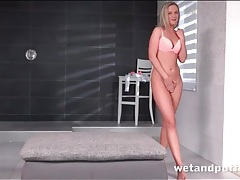 Blonde vinna reed pees on the tile floor tubes