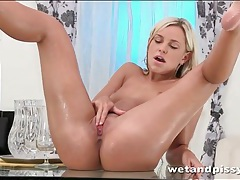 Hot blonde pees in a glass and makes a mess tubes