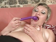 Granny in black stockings gets sexy with a toy tubes
