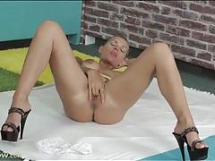 Inked beauty keeps her heels on as she masturbates tubes