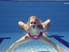 Bikini girl wants to swim naked in the pool tubes