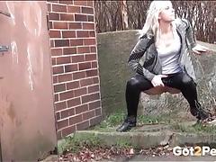 Wet look leggings on a girl pissing outdoors tubes