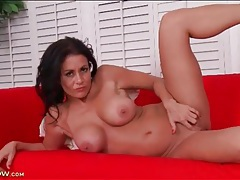 Lusty milf in the throes of ecstasy as she masturbates tubes