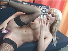 Chick in fishnets fucks a toy into her hot hole tubes