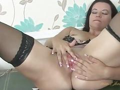 Milf on a desk rubbing her throbbing clit tubes