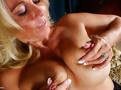 Pretty blonde mature babe plays with her big tits tubes