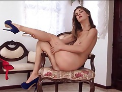 Blue heels on a tall chick rubbing her cunt tubes