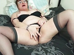 Mature seductress in stockings and a garter belt tubes
