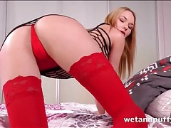 Red stockings are stunning on her long legs tubes