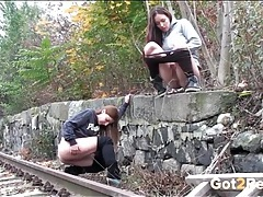 Friends piss by the railroad tracks tubes