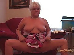 Chubby mature chick in a dress plays with her cunt tubes