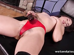 Hairy pussy girl takes a huge piss tubes