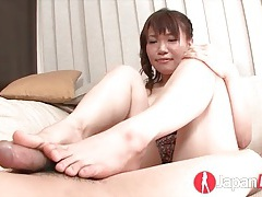 Japanese sweetheart in a camisole plays with his dick tubes