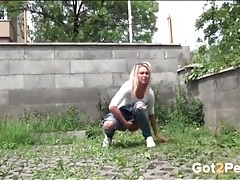 Blonde caught pissing in the weeds tubes