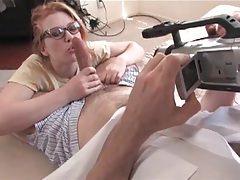Redhead in nerdy glasses sucks a long dick tubes