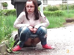 Cute sweater and jeans on a chick pissing outdoors tubes