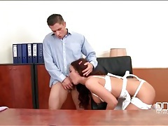 Secretary blows her boss on his desk tubes