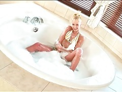 Bikini cutie with tiny tits gets in the hot tub tubes