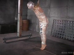 Head to toe plastic wrap and rope bind a slave tubes
