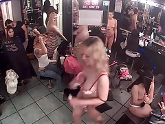 Strippers do their hair in changing room security footage tubes
