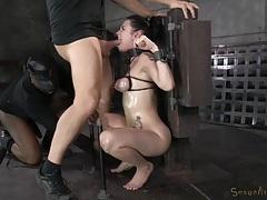 Iron cuffs bind veruca james as she chokes on cock tubes