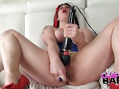 Cutie in a costume strips to her corset to fuck toys tubes
