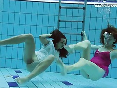 Cuties in lingerie jump in the pool for a swim tubes