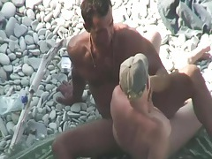 Wife plays with his balls as he jerks off tubes