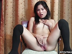 Sweet asian strips and fucks her cunt with a toy tubes
