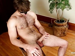 Solo hairy hunk jerks off and cums tubes