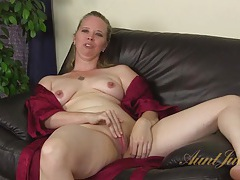 Milf opens her robe and plays with her clit tubes