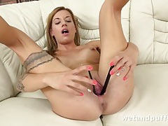Tattooed girl has fun stretching out her pussy tubes