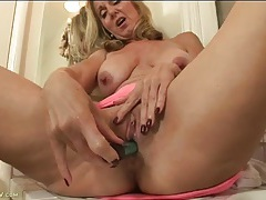 Wet old pussy is exciting as she fucks a toy tubes