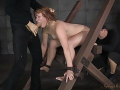 Cocks pound the redhead in naughty bondage tubes