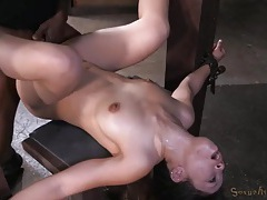 Two big dicks hammer a hot slut in bondage tubes