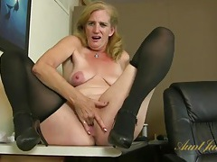 Hot old lady in stockings and heels fingers her pussy tubes