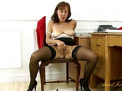 Secretary in black stockings rubs her old cunt tubes