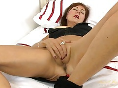 Black fishnet pantyhose cling to her mature ass and legs tubes