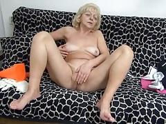 Horny grandma fondles her tits and rubs her cunt tubes