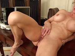 Huge clit and fake tits on this classy mature chick tubes