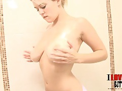 Pink bikini babe oils up her tits in the shower tubes