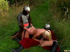 Knights double penetrate a slutty blonde in the grass tubes