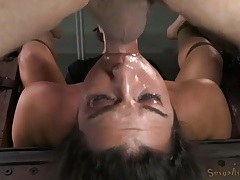 Cute sub girl in their dungeon gets fucked on bondage tubes