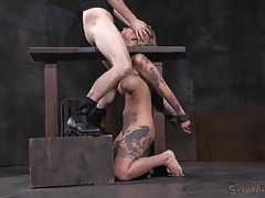 Tattooed body babe in bondage opens wide for face fucking tubes