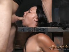 Weights hang off the nipples of a bound slut tubes